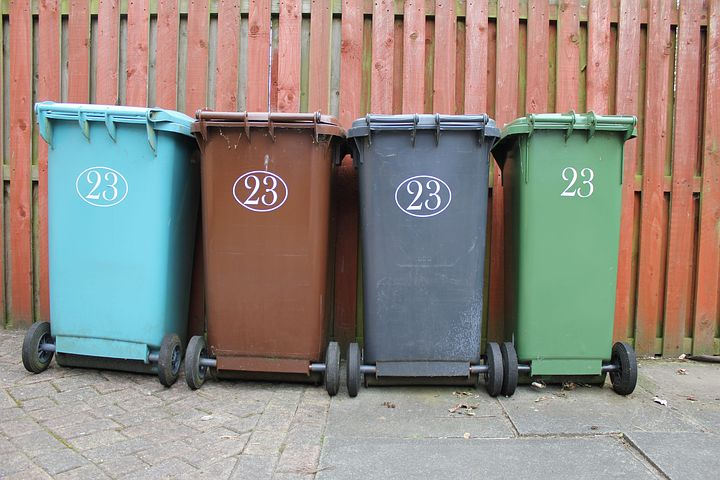 differently colored garbage bins